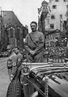 Adolf Hitler waiting for SA 'Brownshirts', Nuremberg, Germany, 1935. Hitler (1889-1945) in Nuremberg for the 7th Party Congress, named the 'Rally of Freedom' by the Nazis. A print from Adolf Hitler. Bilder aus dem Leben des Führers, Hamburg: Cigaretten/Bilderdienst Hamburg/Bahrenfeld, 1936. (Photo by The Print Collector/Print Collector/Getty Images)